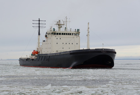 Icebreaker ship on the ice in the sea 스톡 콘텐츠