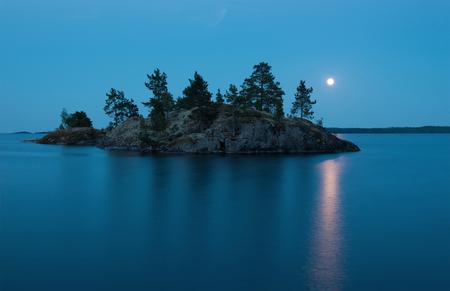 Large Moon over small island. Light nights. Ladoga Lake.