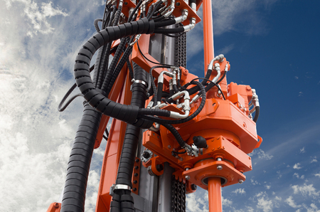 Elements of Hydraulic crawler oil drill machine on blue sky background Stock Photo