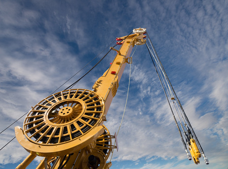 Elements of large mobile construction cranes tower on blue sky background