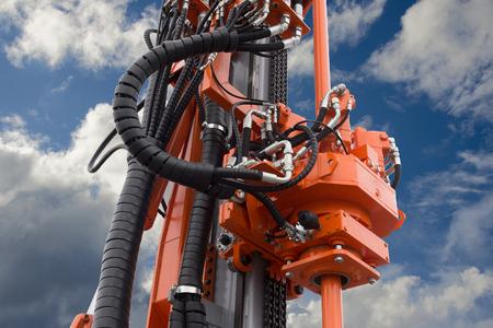 Element of Hydraulic crawler oil drill machine on blue sky background