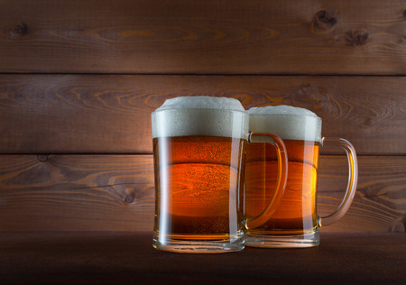 Two glasses of golden beer on wooden background Stock Photo