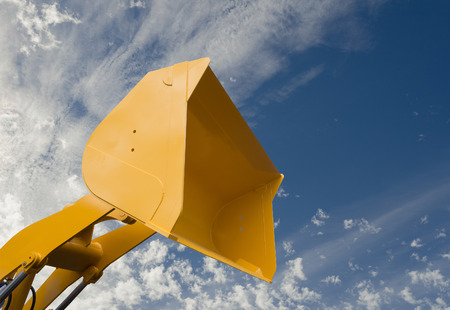 Hydraulic detail of crane arm and basket on sky with clouds background