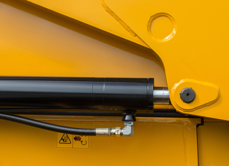 Detail of hydraulic bulldozer piston excavator arm. Closeup of a construction machinery hydraulic equipment.