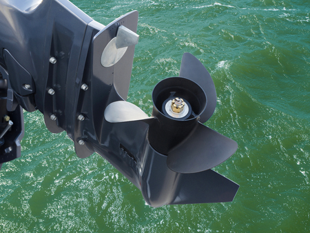 Screw of motor boat on sea water background