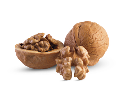 Walnuts, whole half and core closeup isolated on white background. This image has better resolution and quality, and absolute sharpness from foreground to background.