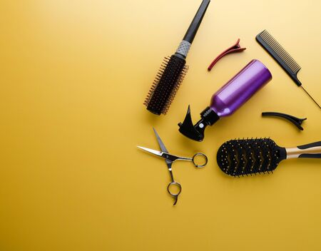 Top view of professional hair dresser tools on yellow background Stock fotó