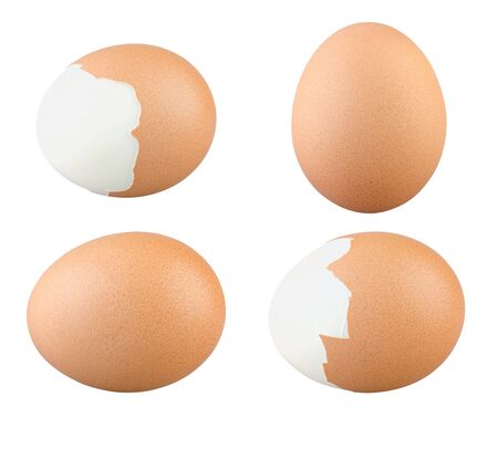 Set of Eggs Isolated. Boiled and Fresh Chicken Eggs on White Background. Highly Retouched Closeup. Full Depth of Field. Brown Eggs Absolute Sharpness High Resolution and Quality Image.
