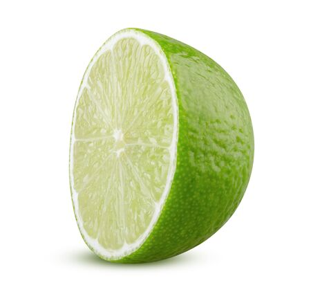 Half of lime isolated. Lime half cut closeup on white background. Green citrus retouched closeup. Lemon sliced. Lime isolated. Textured citron part raw and ripe. Sour tropical fruit