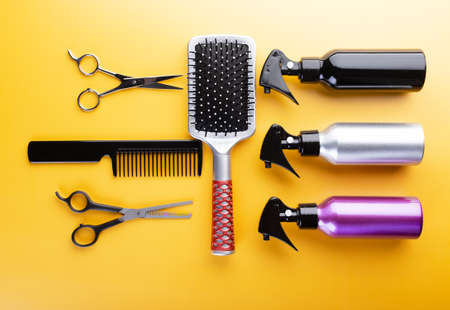 Hair care salon equipment set. Top view of tools for hairdressing and hairstyle supplies: scissors for thinning hair, spray bottles, hairbrushes and combs
