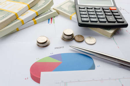 Business and finance concept with calculator, financial papers, documents with diagrams and money, close up view. Project planning, banking, accountant and business revenue