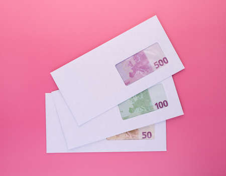Money in envelope. Stack on closed envelopes with euro banknotes for black salary payment or business corruption and bribery. Finance and economics concept