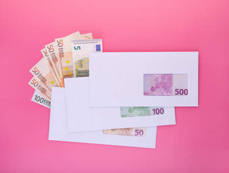 Money in envelope. Stack of closed envelopes with euro banknotes for black salary payment or business corruption and bribery. Finance and economics concept