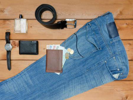 Men casual outfits and accessories on wooden background.