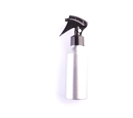 Cosmetic spray bottle isolated on white background. Closeup of plastic container for hair care or skincare with trigger pump. Aerosol jar, beauty salon tool Standard-Bild