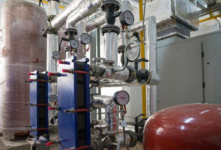 Heating system boiler room equipments. Boilers, pressure gauges and pipes