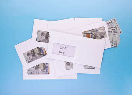 Dollar bills in closed white envelopes for business bonuses, illegal salary, revenue, corruption, bribery or donation concept