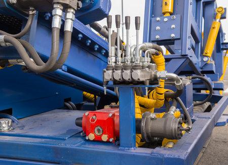 Levers and pressure control unit of the hydraulic machine closeup