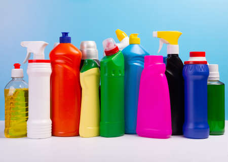 Cleaning concept. Set of cleaning detergents in colored plastic bottles. Clean house.
