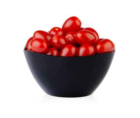 Fresh ripe cherry tomatoes in dark bowl isolated on white background Standard-Bild
