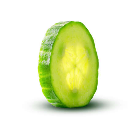 Cucumber slice with a magic glow from inside isolated on white background. Fresh cut cucumber closeup detailed fresh and juicy. Organic healthy food. Delicious sliced cucumber.