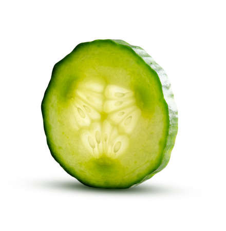Cucumber slice with magic glow from inside isolated on white background. Fresh cut cucumber closeup detailed fresh and juicy. Organic healthy food. Delicious sliced cucumber. Stock Photo