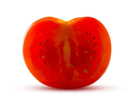 A slice of fresh tomato glows from inside. Delicious vegetable concept. Stock Photo