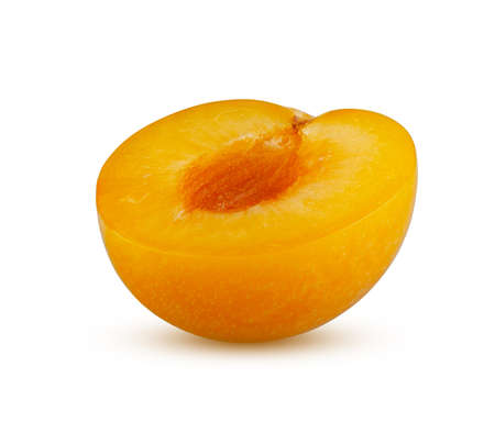 Perfectly retouched half of yellow plum isolated on white background. Full depth of field