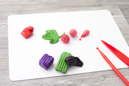 clay craft: modeling clay craft projects in the classroom work at school on a wooden table Stock Photo