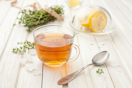 herbal teas with lemon and thyme on the garden table Reklamní fotografie