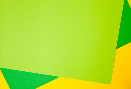 Yellow, green and light green colored sheets. Background image.