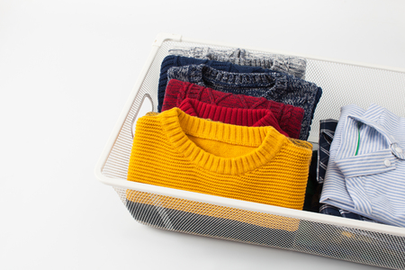 lavish: Clothing folded for vertical storage in the linen drawer. Place for text.