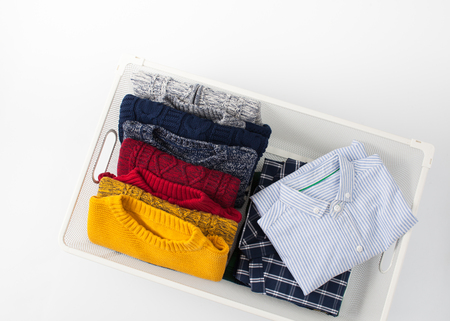 clothe: Clothing folded for vertical storage in the linen drawer. Place for text.