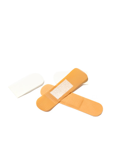 Two plasters on white background. Place for the text.