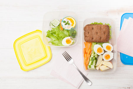 Snacks with you in the container for meals at school and at work. Space for text, background image.
