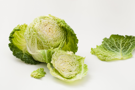 Cooking with fresh Savoy cabbage. Background image.