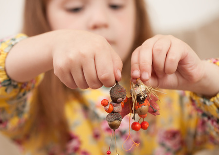 Souvenirs from natural materials with your child with your own hands. Teaching making crafts from pine cones, acorns, autumn leaves, twigs, berries.
