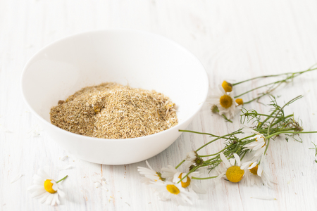 Recipes of traditional medicine, camomile house. Immunity enhancement in alternative medicine. Recipes of the cosmetics with chamomile. An empty space to insert text.