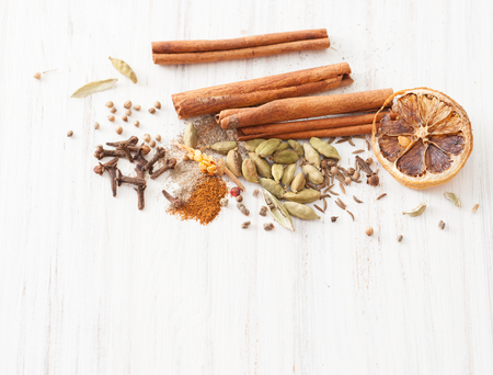 Recipes for mulled wine at home. The use of honey, spices: cinnamon, cardamom, cloves, cumin, coriander, pepper. The place to insert the text. Stock Photo
