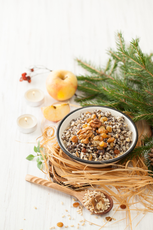 Kutya is a Christmas dish made of wheat grains, poppy seed, nuts, raisins and honey. Porridge, which began the celebration of Christmas. Stock fotó - 88591838