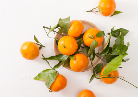 A new crop of tangerines. The beneficial properties of mandarins in cooking and cosmetics. Stock Photo