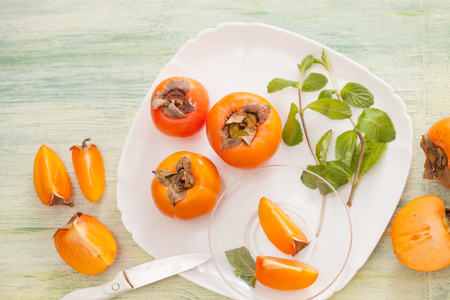 Fresh persimmons in recipes for vegetarian cooking. Low-calorie desserts for the diet.