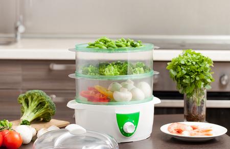 Cooking in the steamer. Healthy food for children and diet. The recipes in the steamer. Stockfoto