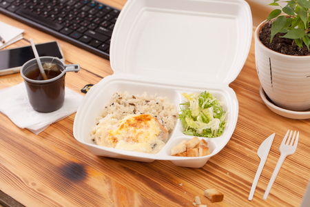 Background image for delivery menu. One-time food container on the Desk in the office. Copy space text