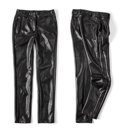 Black leather pants laid out on a white