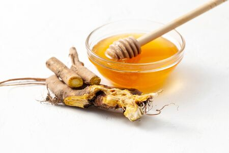 The raw root of the Rumex crispus (yellow dock) plant and honey is used to treat colds and inflammatory processes in folk medicine Stock Photo
