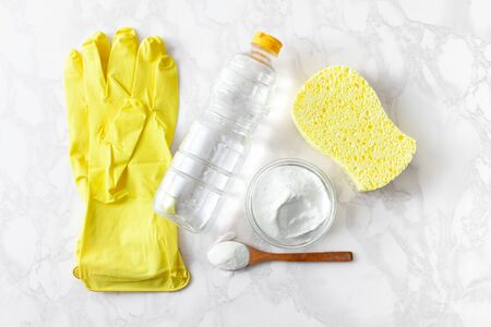 The concept of housework for cleaning kitchen utensils with eco-friendly food powder and vinegar.