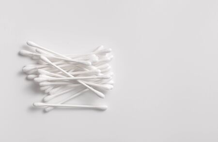 Cotton swabs to remove makeup and cleanse the skin on grey. Copy space text
