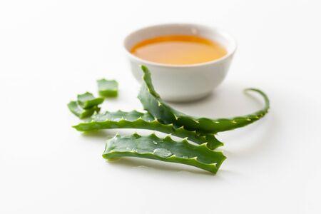 Aloe vera and honey on white