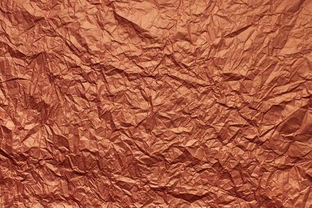 Texture background crumpled packaging red paper with creases and wrinkles. Copy space text